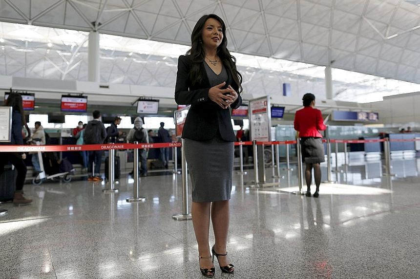 Miss World Canada Anastasia Lin, 25, at the departure hall of Hong Kong's airport yesterday. On Thursday, she was denied permission to board a connecting flight to Sanya, Hainan, where the Miss World pageant will be held on Dec 19.