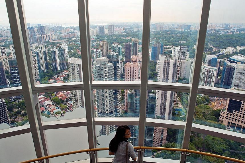 Private and public residential buildings in the Tanglin area as seen from ION Orchard shopping mall. MAS' stress tests show that most households will still be able to service their housing loans even if mortgage rates shoot up from the current 2 per