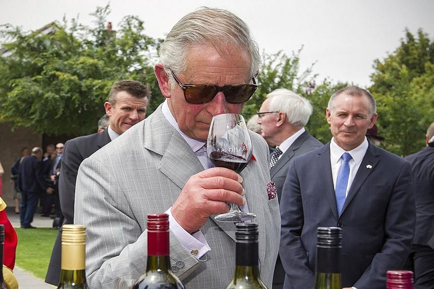 Britain's Prince Charles sampling a red wine at Tanunda in the Barossa Valley area of Australia during his visit early this month. Since 1996, the amount of Australian land used for vineyards has more than doubled.