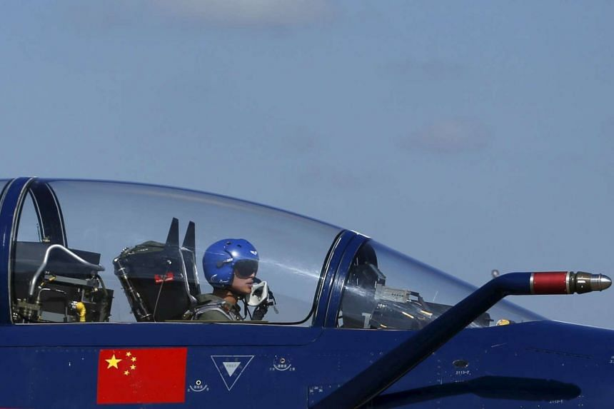 A Chinese fighter jet pilot preparing for a demonstration at the Korat Royal Thai Air Force Base on Nov 24.
