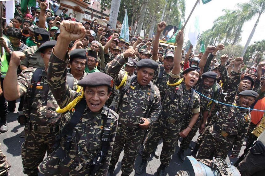 Members of Banser, the youth wing of Indonesia's largest Muslim organisation Nahdlatul Ulama, staging a rally in Blitar city on Sept 30.