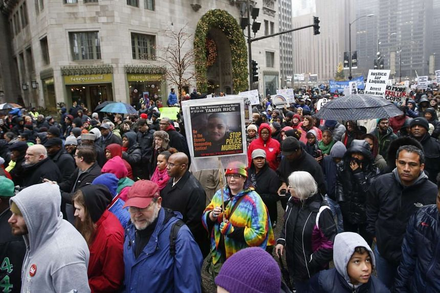 Chanting protesters walk on Michigan Avenue.