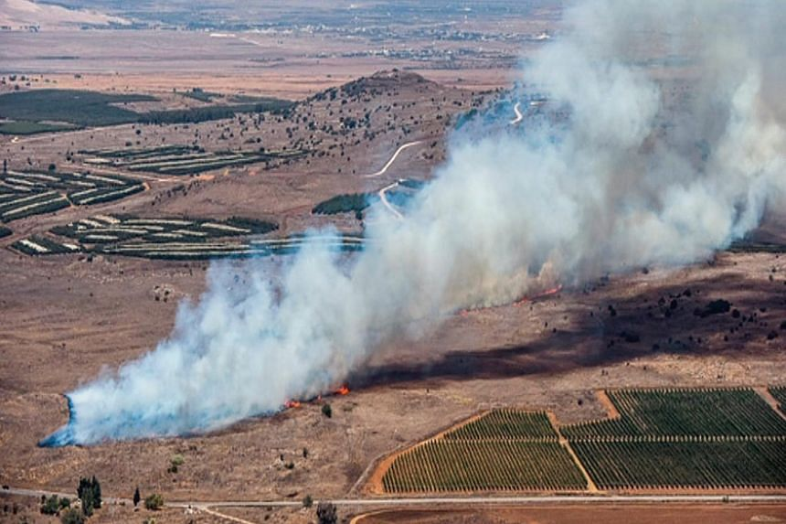 A video still shows smoke billowing from the jet's crash site after it was shot down near the Turkish-Syrian border on Nov 24.