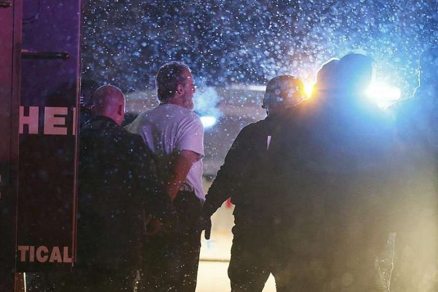 Police in Colorado Springs taking into custody a man who stormed the city's Planned Parenthood clinic and allegedly opened fire. A police officer and two civilians were killed, while nine others - among them five officers - were wounded, though none