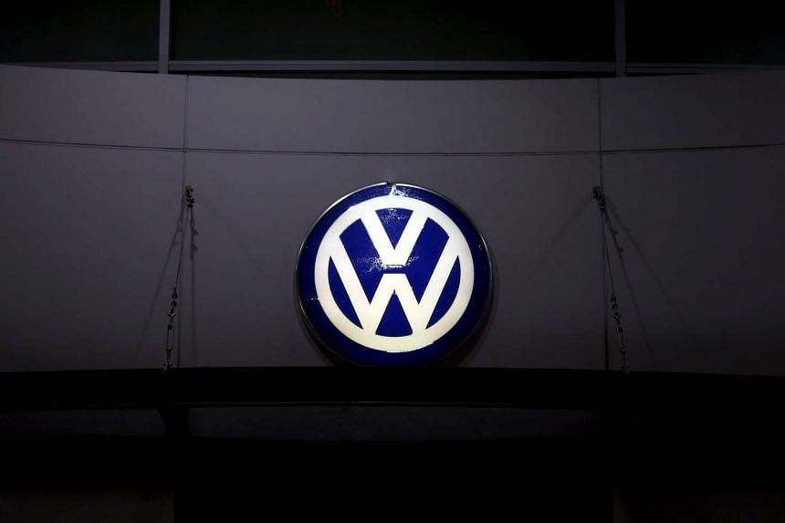 A Volkswagen logo is illuminated at a dealership in Seoul, South Korea on Nov 25, 2015.