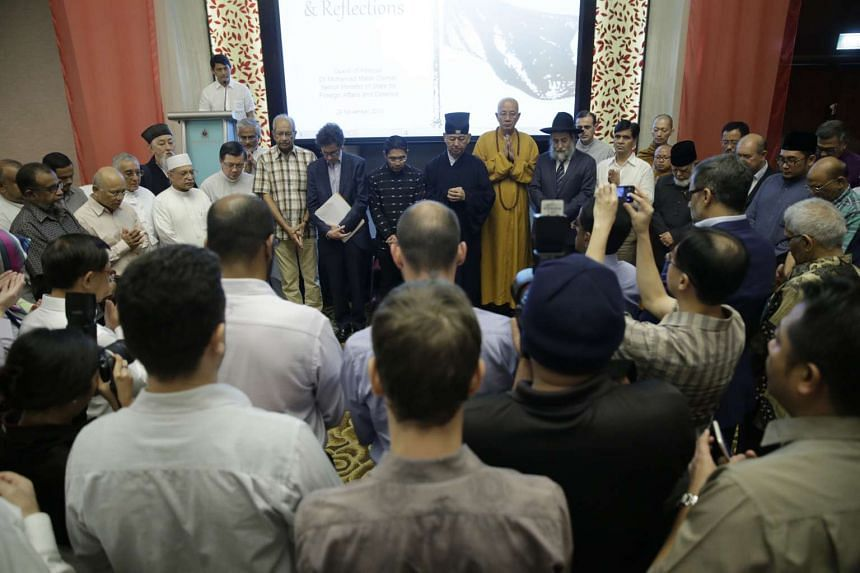 Leaders and representatives from all major faiths in Singapore congregate for a silent prayer during A Gathering of Remembrance and Reflection on Nov 29, 2015.