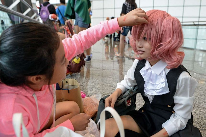 Cosplayers prepare for the Anime Festival Asia 2015.