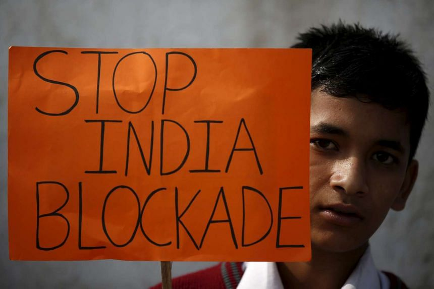 A student holding a placard during a protest to show solidarity against the border blockade in Kathmandu, Nepal, on Nov 27, 2015.