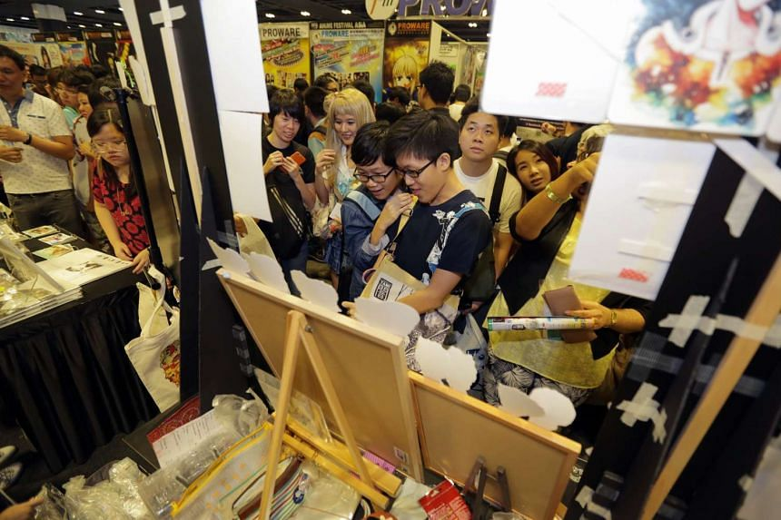 Members of the public and cosplayers alike gather to purchase exclusive merchandise.