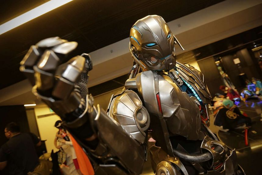 A cosplayer dressed as Ultron from the Avengers franchise.