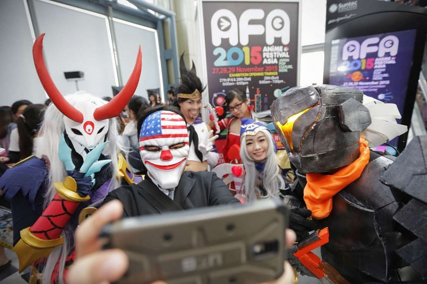 A group of cosplayers taking a selfie at Anime Festival Asia 2015.