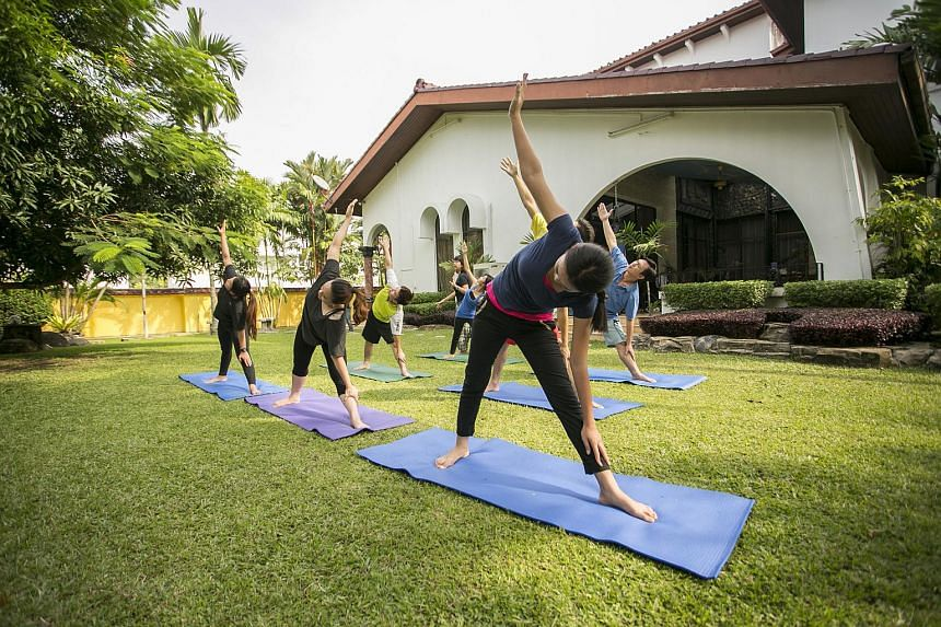 Patients at Solace Sabah drug rehab centre doing yoga as part of their recovery.