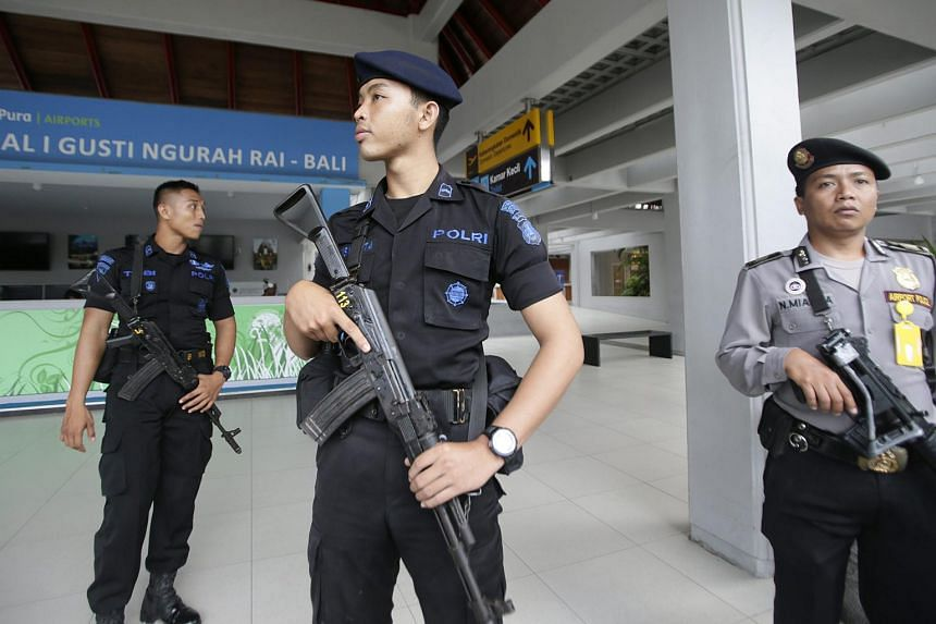 Indonesian military and police officers stand guard at Bali's Ngurah Rai International Airport in Bali, Indonesia, on Nov 28, 2015.