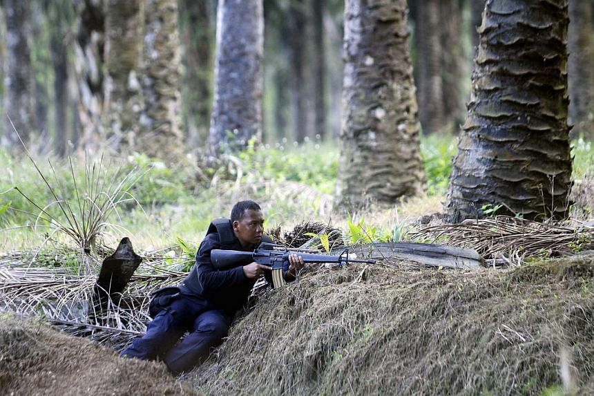 A Malaysian special forces trooper on standby at Lahad Datu in Sabah on Mar 5, 2013.
