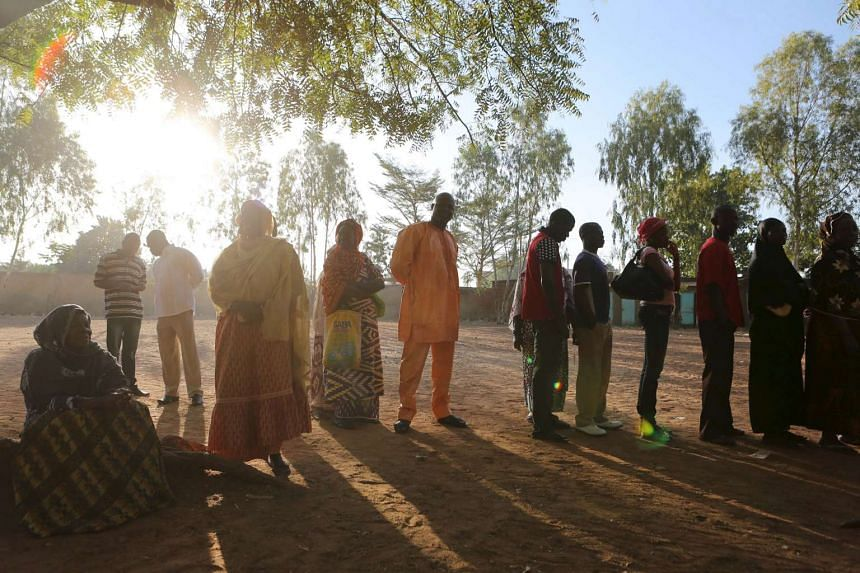 People queuing to vote during the presidential and legislative election at a polling station in Ouagadougou, Burkina Faso, on Nov 29, 2015.
