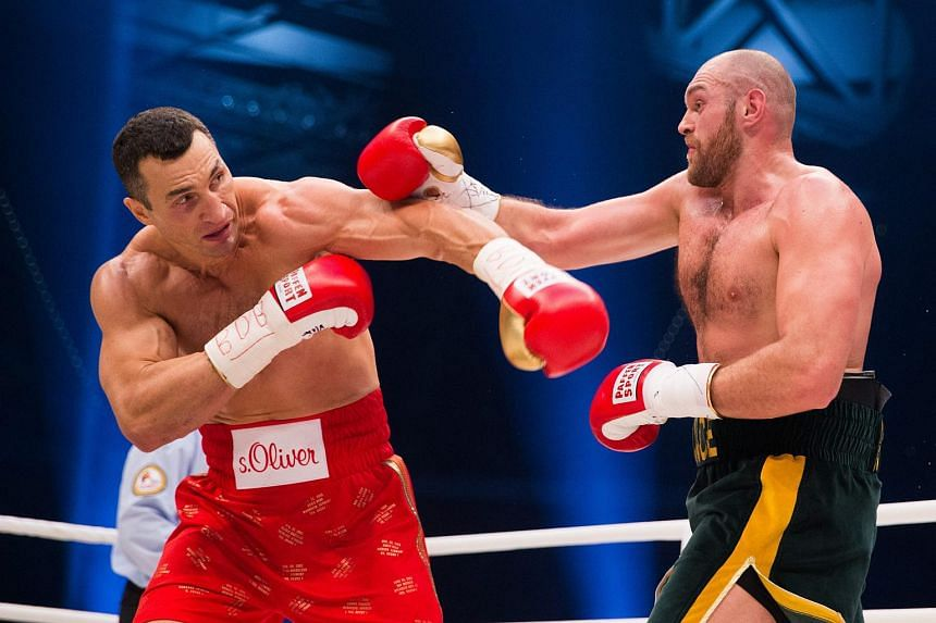 Ukrainian heavyweight boxer Vladimir Klitschko (left) fights against British contender Tyson Fury at the Esprit Arena in Duesseldorf, Germany, Nov 28, 2015.