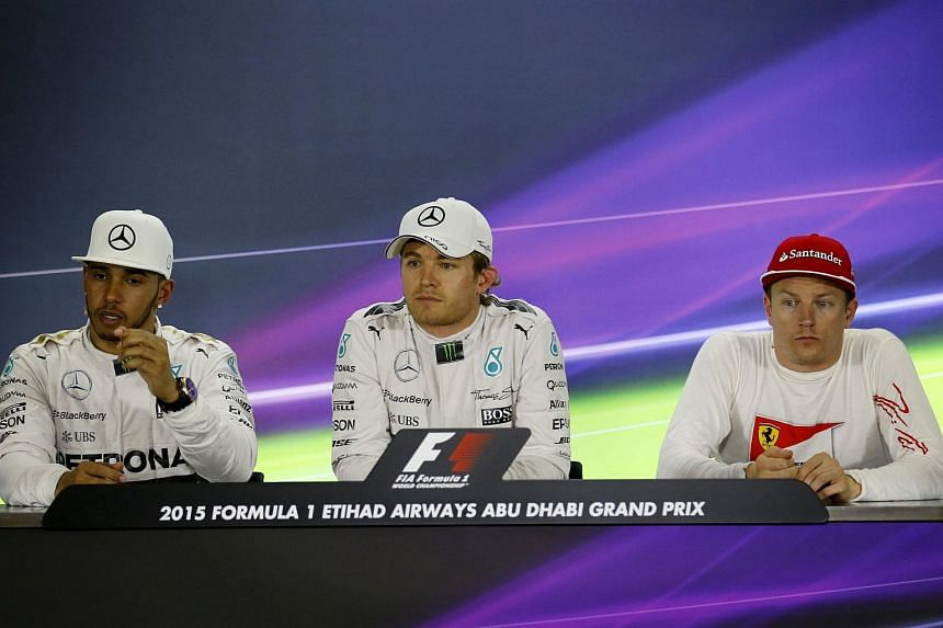 Nico Rosberg (centre), Kimi Raikkonen (right) and Lewis Hamilton (left) at a news conference after the qualifying session of Abu Dhabi F1 Grand Prix at the Yas Marina circuit in Abu Dhabi, Nov 28, 2015.