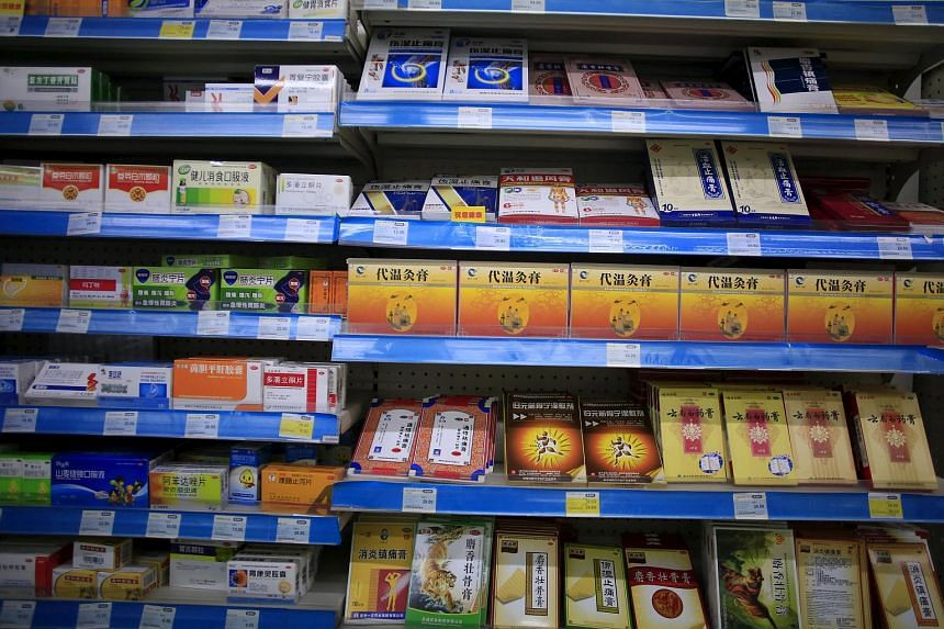 Shelves displaying medicines are seen at a pharmacy in Shanghai, China.