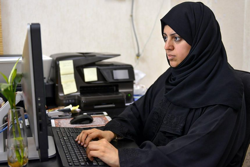 Nassima al-Sadah, a candidate for municipal councils in the Gulf coast city of Qatif, working at her office in Qatif 400 kilometers east of the Saudi capital, Riyadh.