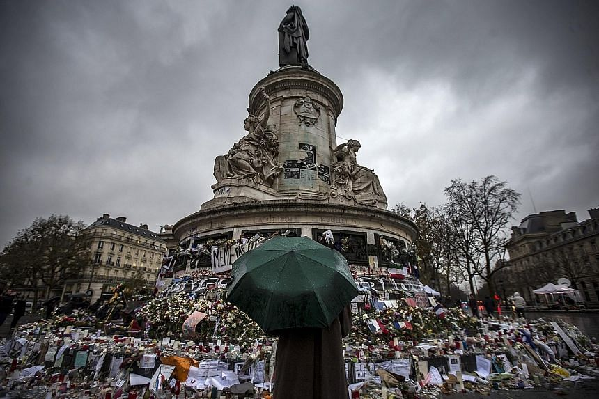 A memorial for victims of the Nov 13 Paris attacks, on Place de la Republique in Paris last Tuesday. There is significant difficulty in trying to anticipate the effects of geopolitical tensions on financial markets, and even if the impact is real, th