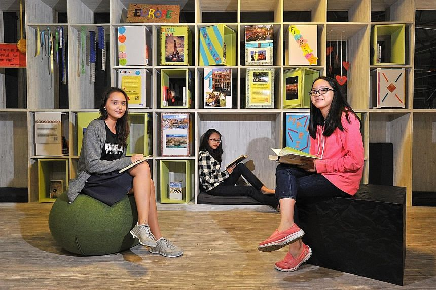 (From left) Coral Secondary student Eliisa Abdullah, 15; Springfield Secondary student Mo Mo Banyar, 13; and CHIJ St Nicholas Girls' Secondary student Natalie Goh Hui Shi, 14, at the new Teens' Mezzanine at Pasir Ris Public Library. The new mezzanine