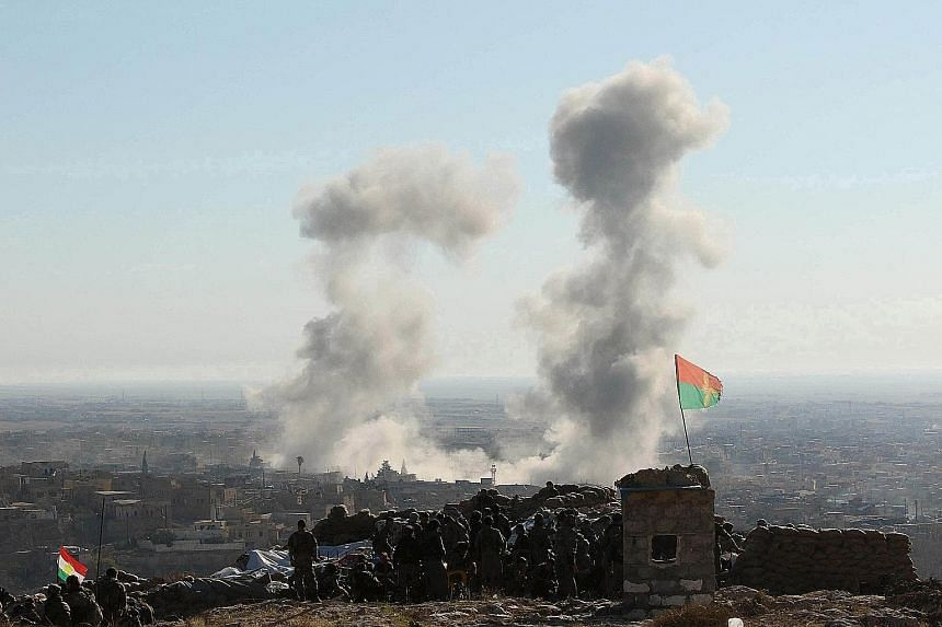 Smoke rising from the site of US-led air strikes against ISIS militants in the town of Sinjar, Iraq, on Nov 13. However, in general, analysts say the fight against the terrorist group has made very slow progress.