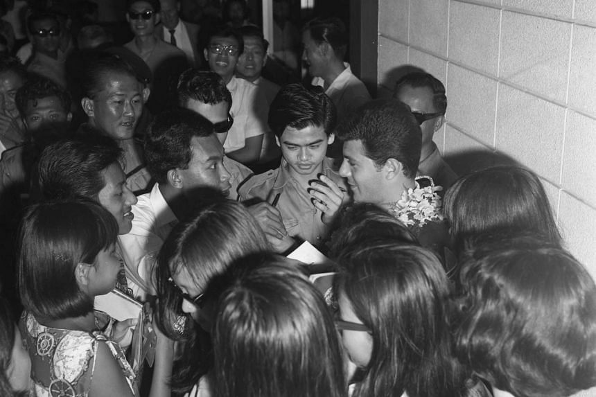 Avid fans swarming around teen idol Frankie Avalon on his arrival here to promote a new film.