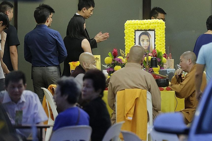 Grieving family members, relatives and friends at the wake of Ms Soh Yuan Lin, 23, in Sin Ming Drive yesterday.