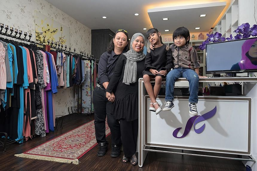 Ms Azrina Tahar with husband Jasman Johari, daughter Sufia Jaide and son Wildan at her shop in Tanjong Katong Complex. Her ambition is to turn Sufyaa into a one-stop fashion house, with services ranging from manufacturing to photography to even consu