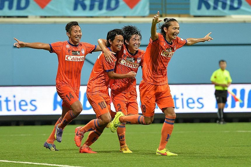 Albirex Niigata celebrating their Singapore Cup win on Friday night to complete the Cup double. There are calls for Singapore internationals to be spread among the local S-League clubs.