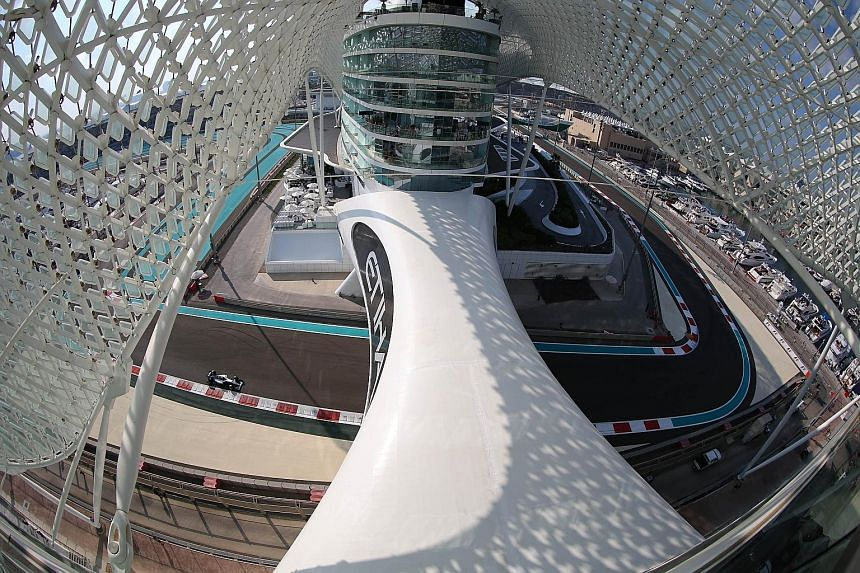 Nico Rosberg (left) took pole position at the Yas Marina circuit in Abu Dhabi ahead of Mercedes team-mate, the 2015 champion Lewis Hamilton.