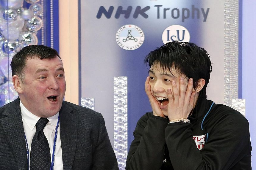 Yuzuru Hanyu bringing the house down with his stunning performance at the ISU Grand Prix figure skating NHK Trophy in Nagano before celebrating with his Canadian coach Brian Orser (far left). Hanyu's 322.40-point total was way above the previous reco