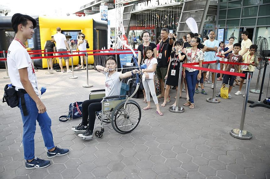 A visitor at the Asean Para Games Carnival trying out wheelchair archery.The carnival is open until Dec 9, from 10am to 9pm, and 8am to 9pm on Dec 5.