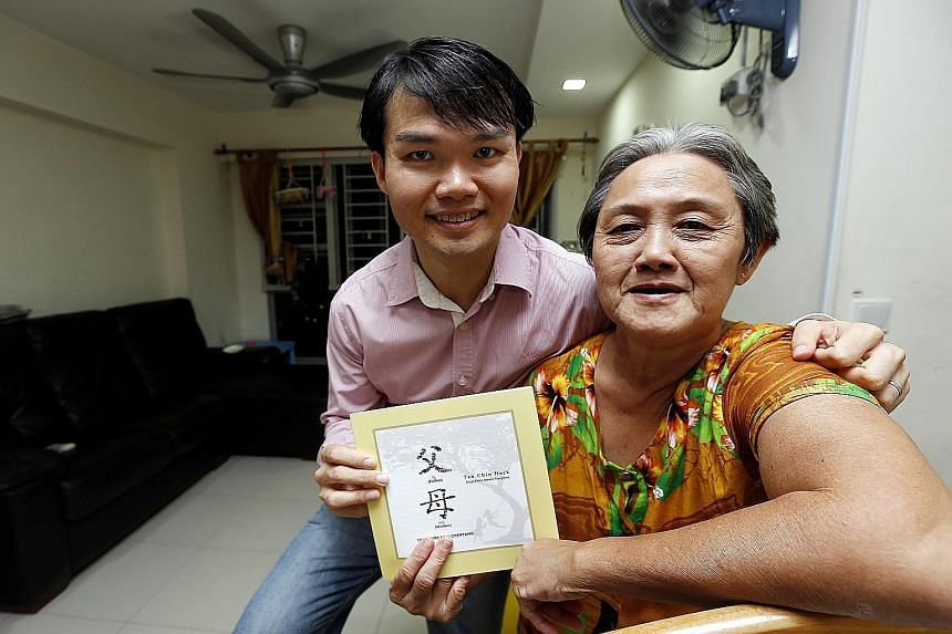Mr Tan Chin Hock and his mother, Madam Foo Lian, holding the book Father, Mother that Mr Tan authored.