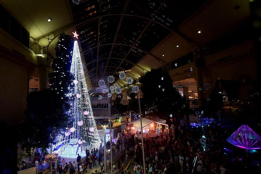People gathering to observe the Guinness World Record attempt for the most lights on an artificial Christmas tree in Canberra, Australia, late last Thursday. The 22m tree set a new record with 518,838 lights, beating the previous record held for five