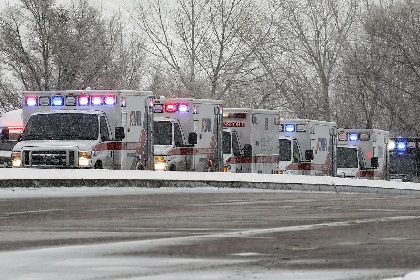 The suspect has been identified by police as Robert Lewis Dear (above). Ambulances at the scene of the shooting (left).