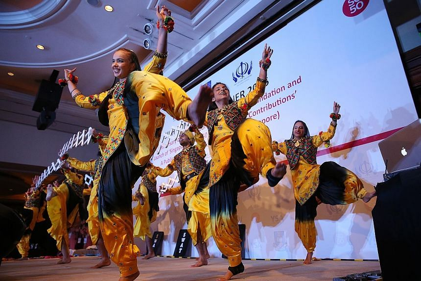 A bhangra dance performance at the dinner to celebrate Singapore's Golden Jubilee at Raffles Town Club last night. Prime Minister Lee Hsien Loong, the guest of honour, spoke about the Sikh community's contributions, noting how it has a tradition of s