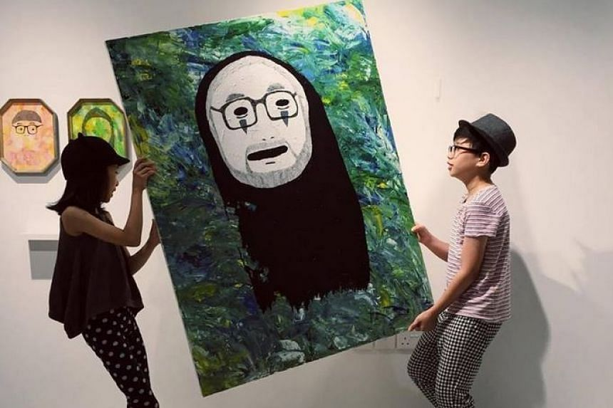 Renn (right) and Aira Lim taking down an art work from their exhibition at the National Gallery Singapore's Gallery & Co cafe.