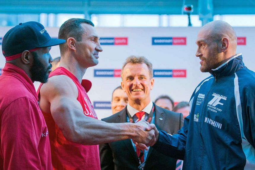 Klitschko (left) and Fury shake hands at the official weigh-in in Essen, Germany.