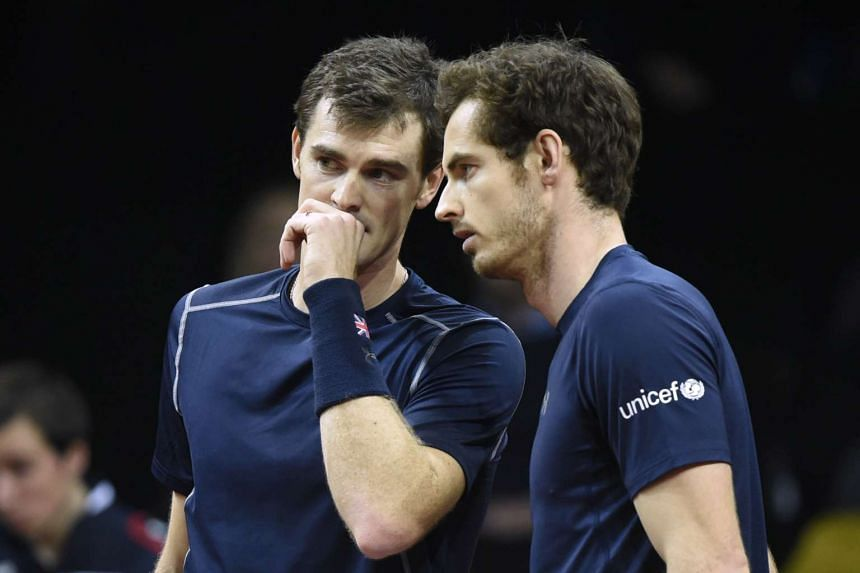 Jamie (left) and Andy Murray (L) talk during the doubles tennis match on the second day of the Davis Cup final.