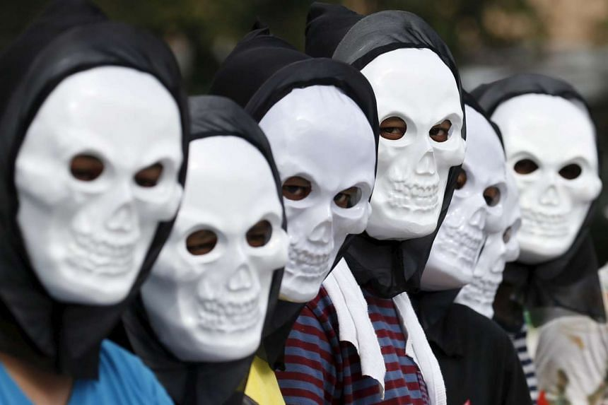 Filipino environmental activists wear skull masks as they take part in the global climate protest.