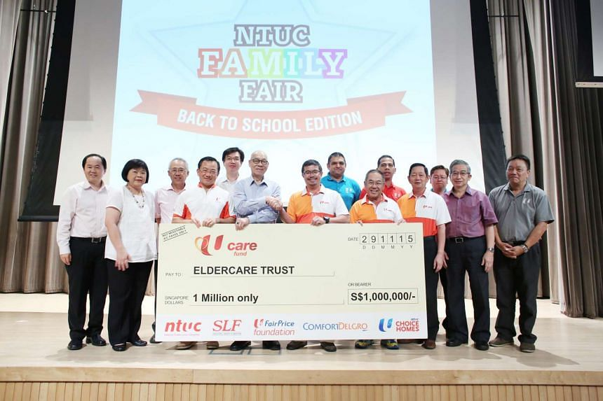 NTUC assistant secretary-general Zainal Sapari (third from left) presenting the cheque to Eldercare Trust chairman Cyrille Tan (second from left) on Nov 29, 2015.