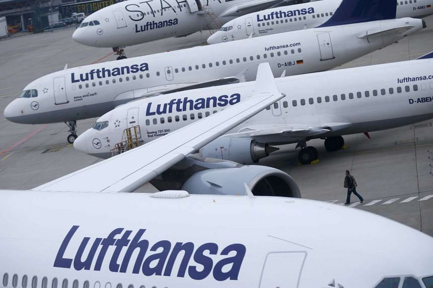 Lufthansa planes parked on the tarmac at Frankfurt airport, Germany.