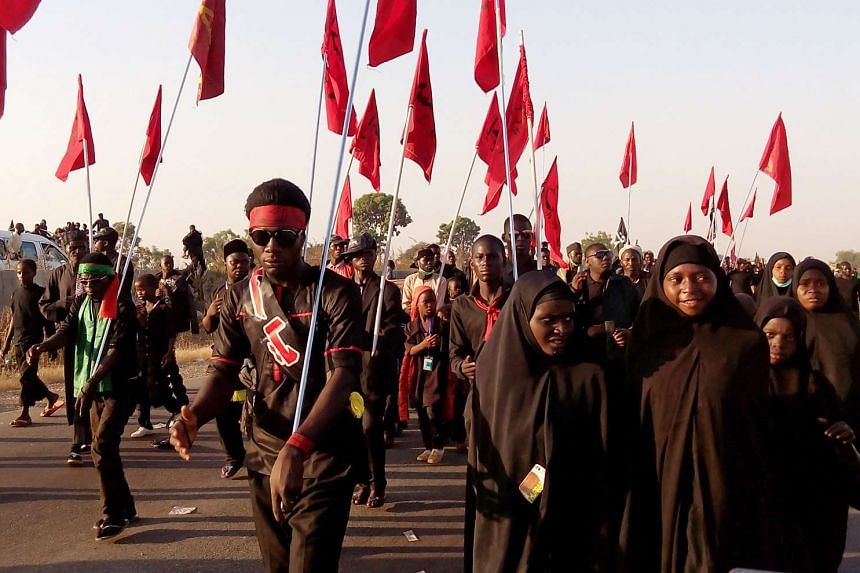 Shi'ite Muslims continuing to march in Dakasoye, northern Nigeria, following the attack.