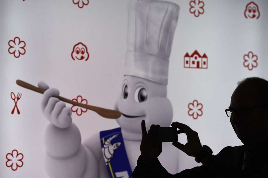 "A journalist takes a picture of a "" Bibendum "", the symbol of the Michelin tire company, during the presentation of Germany's Michelin Guide 2016 in Berlin on Nov 12, 2015."