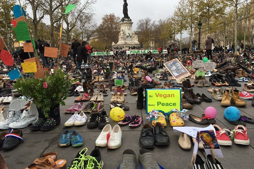 Thousands of people send their shoes in a protest at the Place de la Republique in Paris on Nov 29, 2015, after a planned gathering for climate change activists was cancelled over security fears.