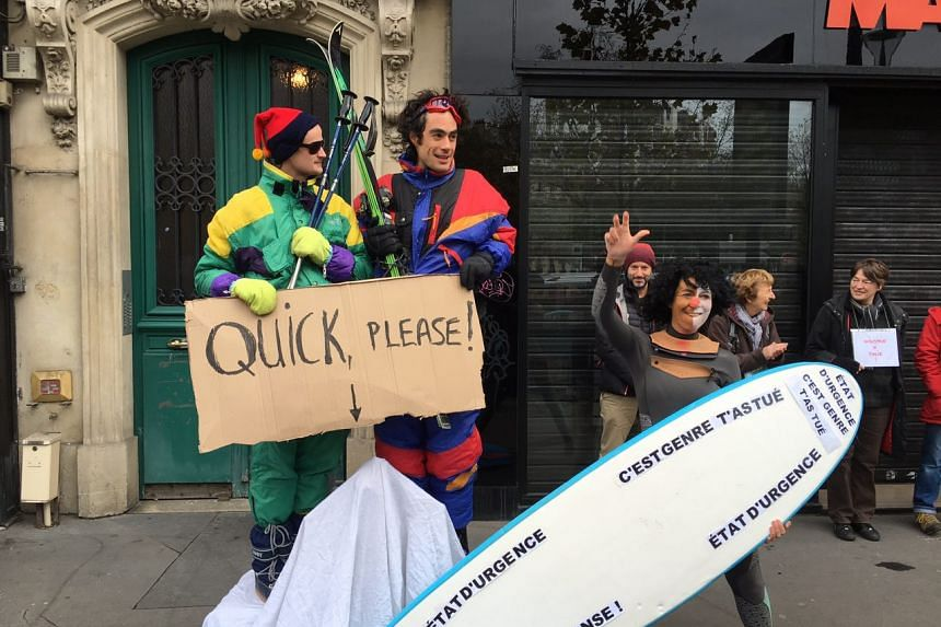 Actors Jock Maitland, 25, from Scotland and Julien Nguyen Dinh, 35, from France turned up for the human chain protest wearing ski suits, and holding skis while standing on a mock up of a snow covered mountain.