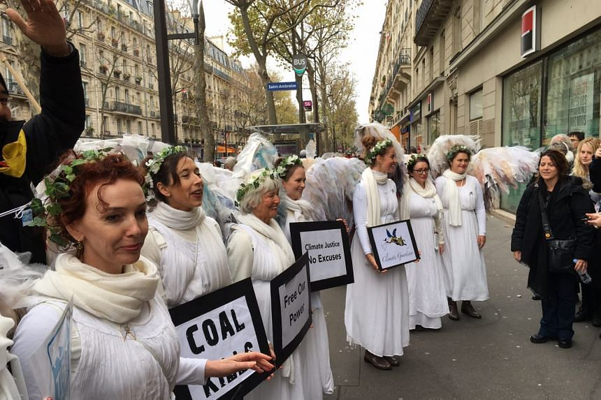A group of seven activists from Australia, who dressed up as angels and called themselves the Climate Guardians, called for an end to polluting energy as they took part in the human chain.