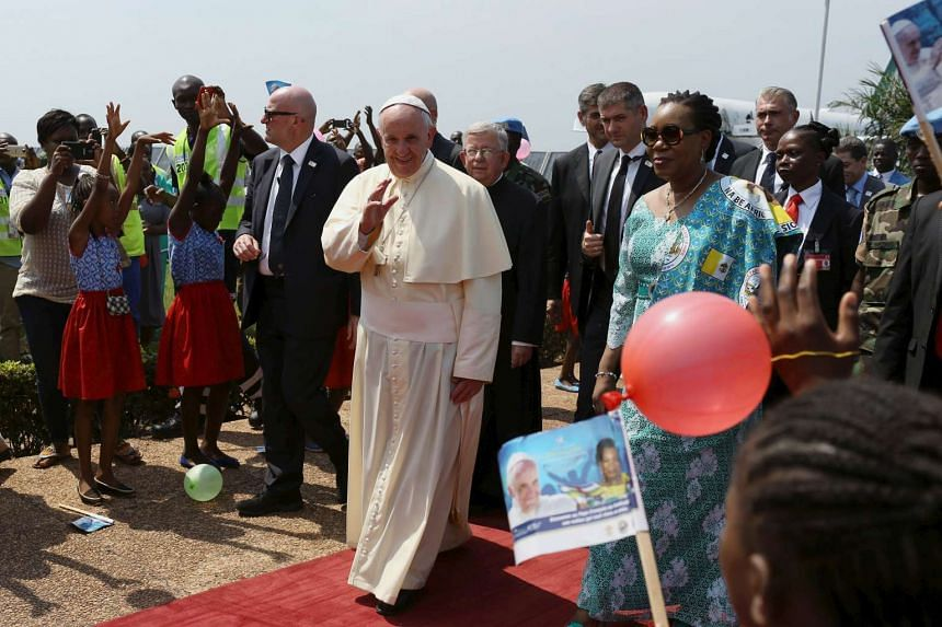 Pope Francis arrives at the international airport of the capital Bangui, Central African Republic on Nov 29, 2015.