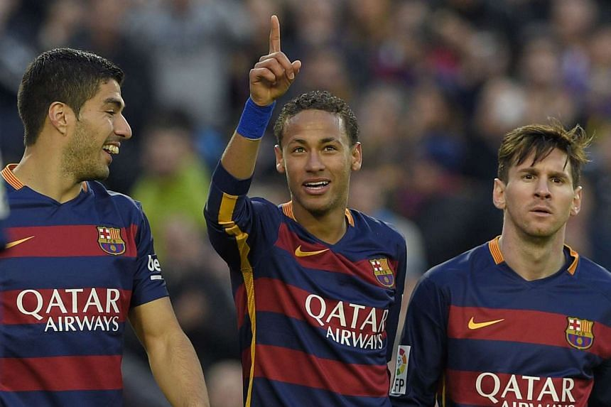 Neymar (centre) celebrates with Suarez (left) and Messi after scoring their third goal.